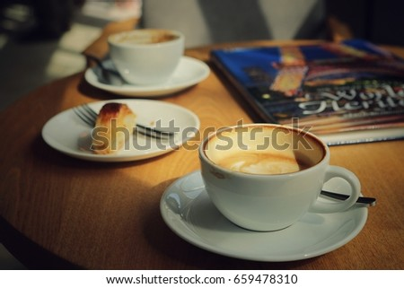 Empty white ceramic coffee mug on wooden