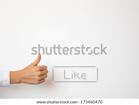 Empty white copyspace with Like button and hand showing thumb up gesture - stock photo