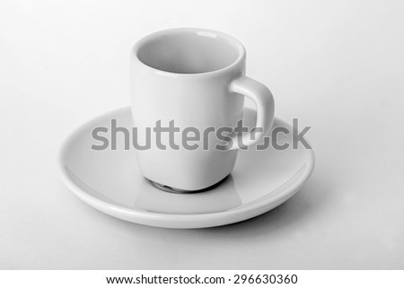 Empty white cup and saucer for tea isolated on white background. - stock photo