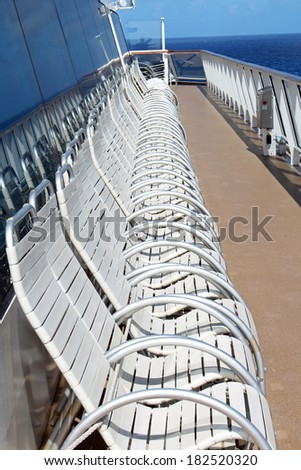 Empty white deck chairs on a cruise ship - stock photo