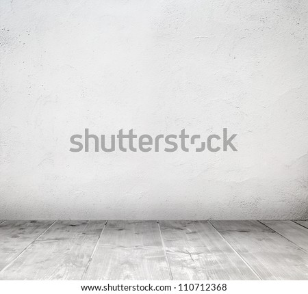 Empty white interior room with painted wall and wooden plank floor - stock photo