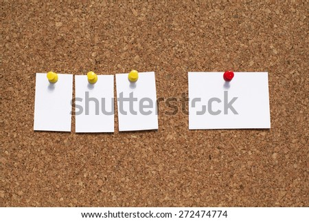Empty White Note Papers Pinned On Cork Bulletin Board - stock photo