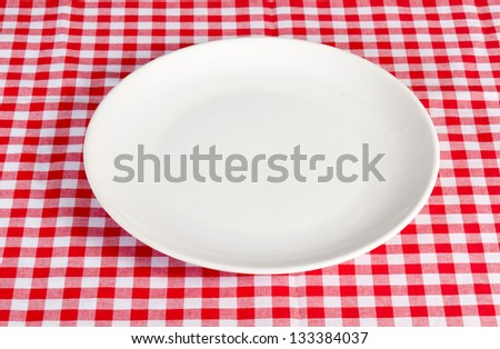 Empty white plate on the table