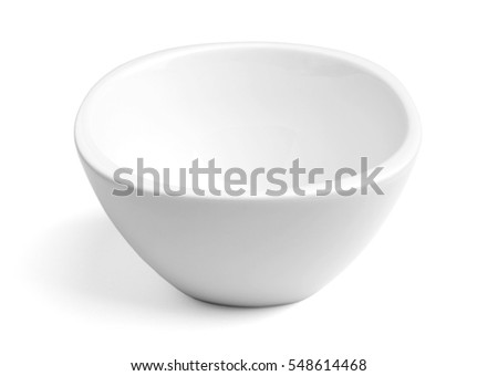 Empty white porcelain dinner bowl on white background with soft natural shadow. Clipping path included
