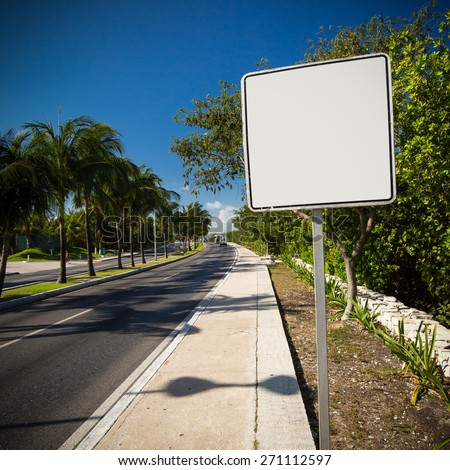 Empty white road sign. Tropical street