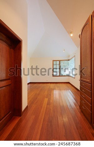 Empty white room with wooden floor - stock photo