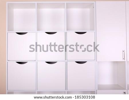 Empty white shelves close up - stock photo