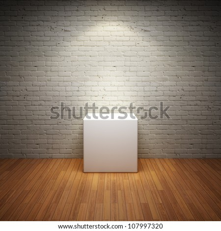 Empty white stand in old interior room with brick wall and light spot - stock photo