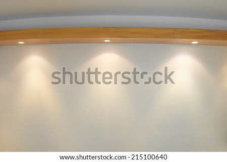 Empty white wall with 3 spot lights - stock photo