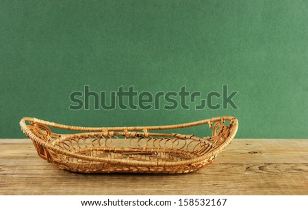 empty wicker basket on a wooden table