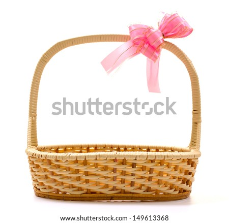 Empty wicker basket with bow isolated on white background - stock photo