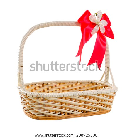 Empty wicker basket with bow isolated on white background
