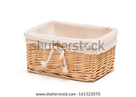 Empty wicker basket with linen lining isolated on white background - stock photo