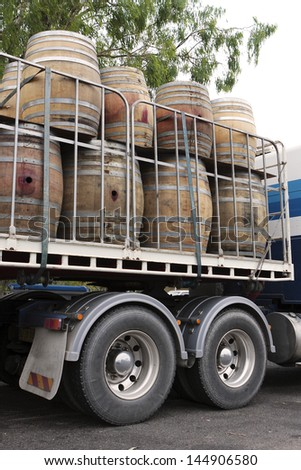 Empty wine barrels being transported on a truck - stock photo