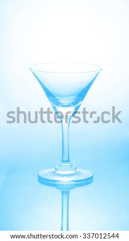 Empty wine glass in soft blue color