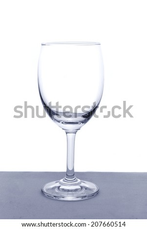Empty wine glass isolated on a white background - stock photo