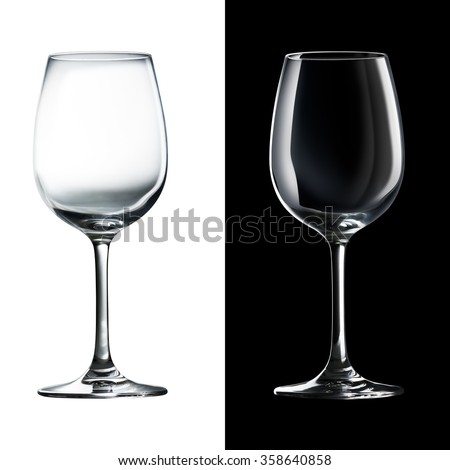 Empty wine glass isolated on black and white - stock photo