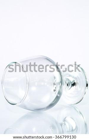 Empty Wine Glass Lying on a white background - stock photo