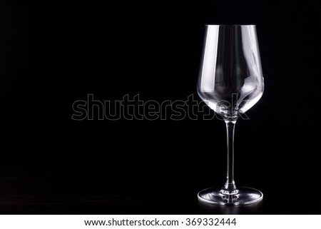 empty wine glass on plain black background - stock photo