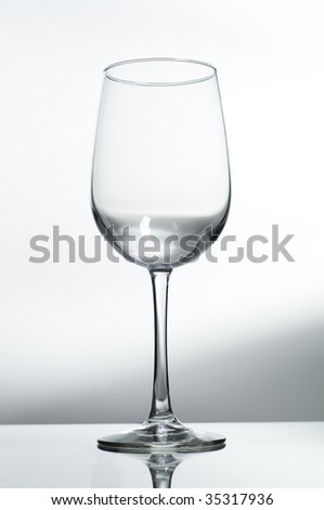 Empty wine glass shot on glass with white background