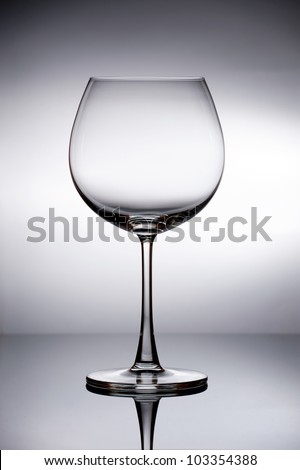Empty Wine Glass with Clear White Background - stock photo