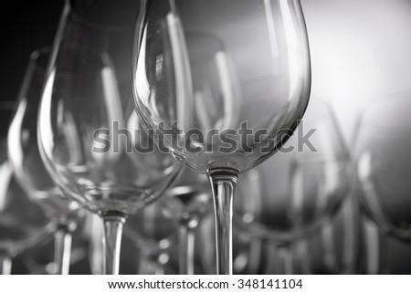 Empty wine glasses on gray background - stock photo