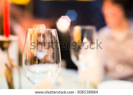 empty wine glasses on the table : blur background - stock photo