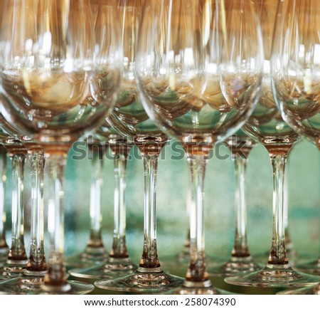 empty wine glasses on the table selective focus with shallow depth of field - stock photo