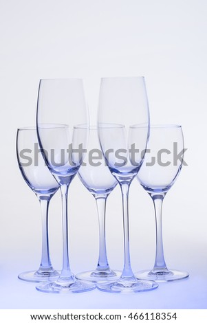 Empty wine glasses with clipping path on  uniform background.
