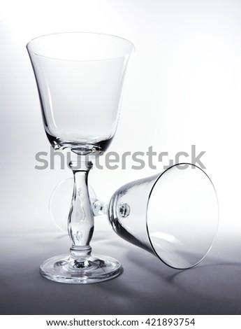 empty wineglasses, high contrast study shot. - stock photo