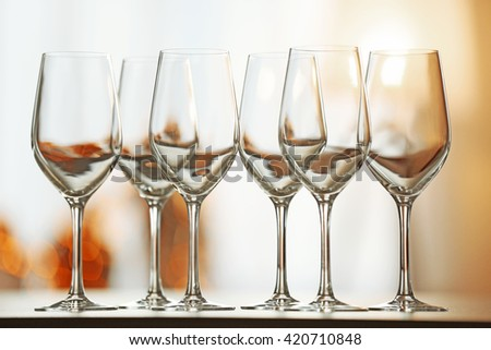 Empty wineglasses on a table, close up - stock photo