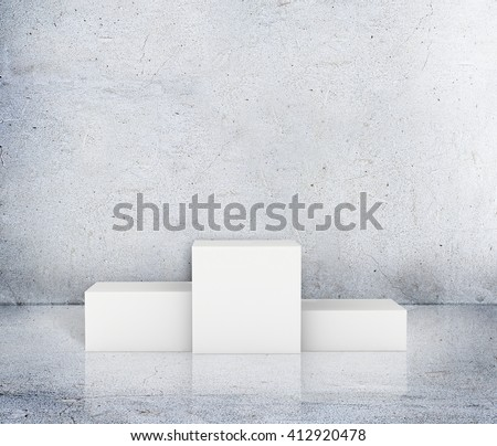 Empty winners podium with first, second and third place for award ceremony - stock photo