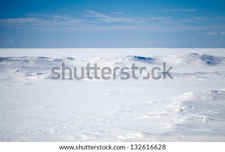 Empty winter landscape. Deep blue sky and snow on frozen Baltic Sea - stock photo