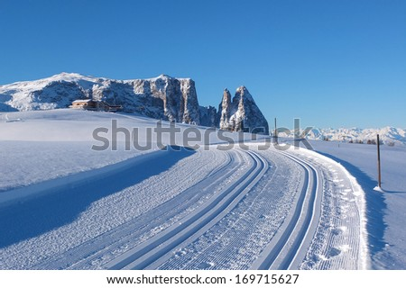 Empty winter road in the Dolomites in Italy
