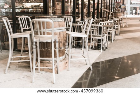 empty wood chair in restaurant - vintage effect filter