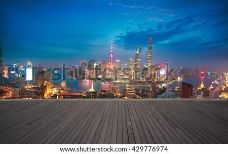 Empty wood floor textured with Aerial photography bird-eye view at Shanghai bund Skyline of night scene  - stock photo