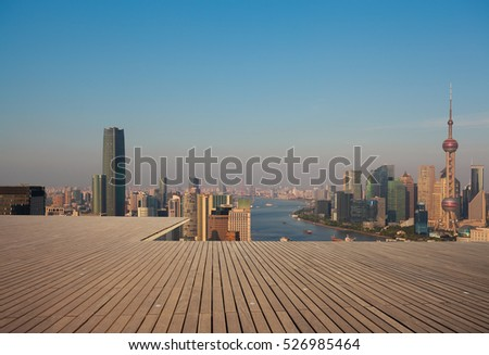 Empty wood floor with modern city landmark buildings of Shanghai bund Skyline
