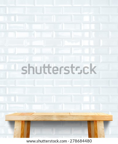 Empty wood modern table and white ceramic tile wall in background,Mock up template for display of your product. - stock photo