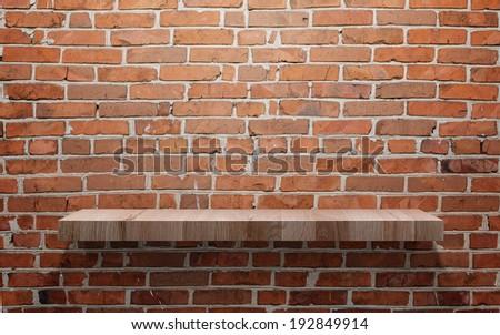 Empty wood shelf on brick wall  - stock photo