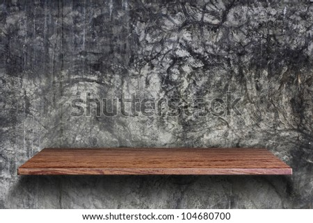Empty wood shelf on Cement wall background - stock photo