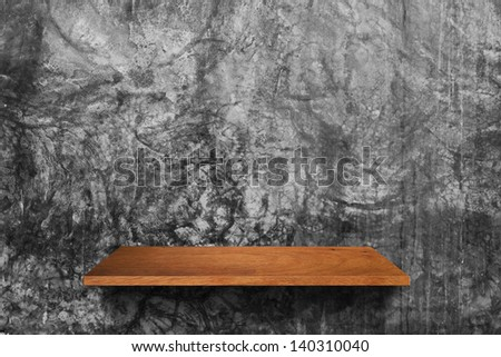 Empty wood shelf on cement wall texture background, Loft style concept design - stock photo