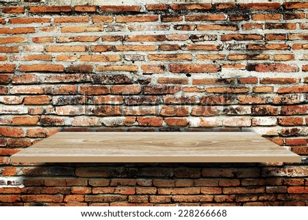 Empty wood shelf on old brick wall background - stock photo