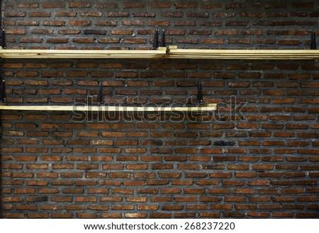 Empty wood shelf on old brick wall background - stock photo