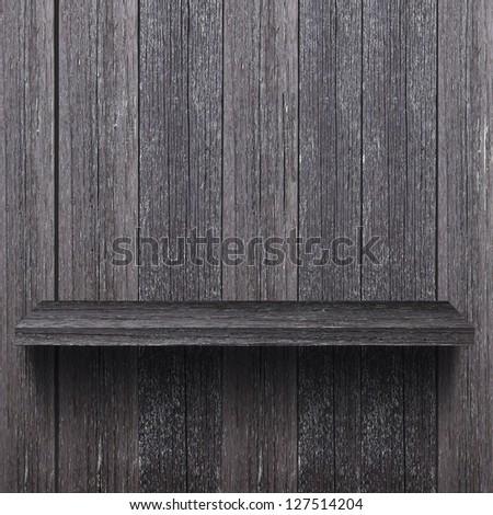 Empty wood shelf on the wood wall - stock photo