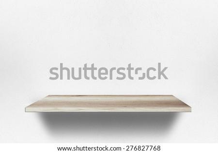 Empty wood shelf on wall - stock photo