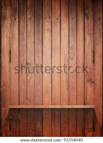 Empty Wood Shelf on wall with light and shadow - stock photo
