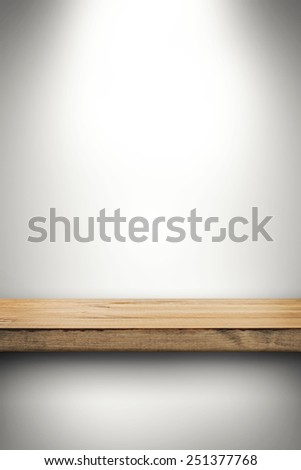empty wood shelf on white wall - stock photo