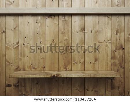 Empty wood shelf on wooden wall - stock photo