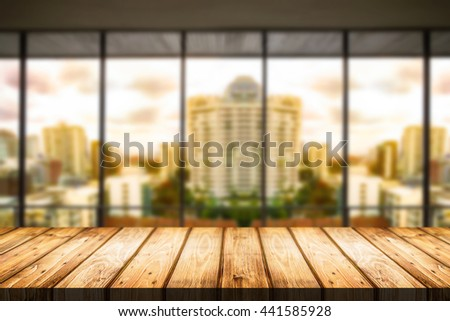 Empty wood table platform with city scape on background for product presentation display montage. - stock photo