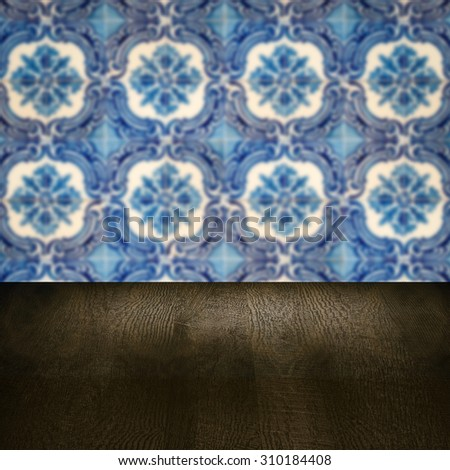 Empty wood table top and blur vintage ceramic tile pattern wall in background, Mock up template for display of your product.